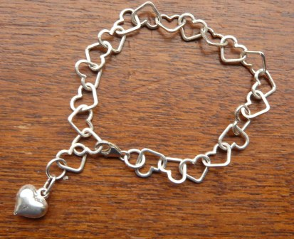 Heart link and charm bracelet