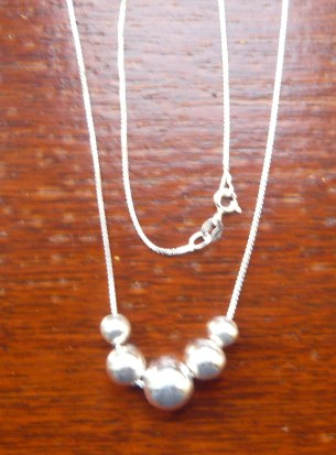 Five bead long necklace