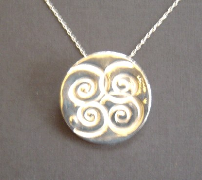 Curly silver motif pendant