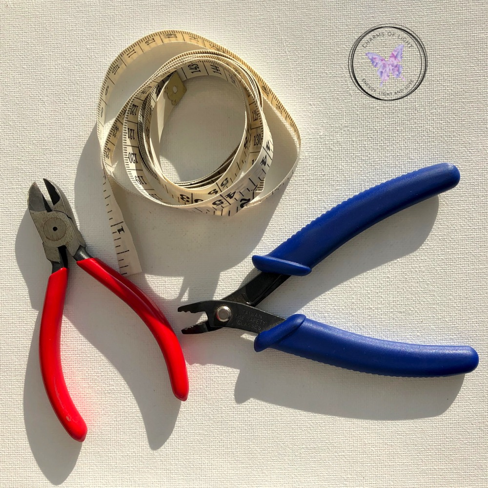 Tape measure, wire cutters, crimping pliers