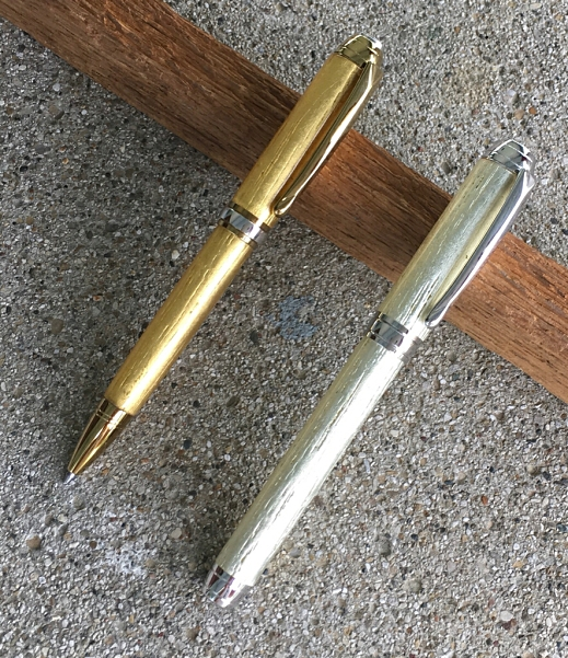 A pair of Beaufort Mistral pen kits made using oak with gold leaf and white gold leaf