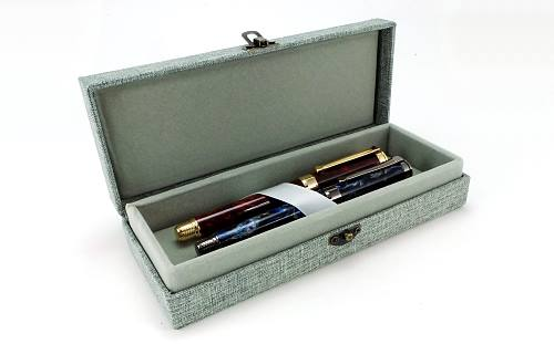 Fabric covered hardshell double pen box with antiqued clasp and velvet interior